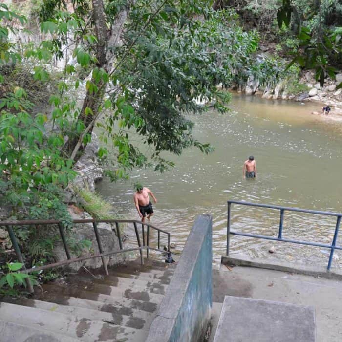 Handy stairs lead into the water at the natural bathing pools at Pasabien Guatemala