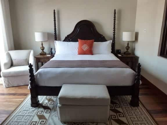 Guest room at Rosewood Hotel San Miguel de Allende m with orange accents
