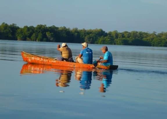 Fishermen on a canoe at Manialtepec Lagoon in Puerto Escondido by day