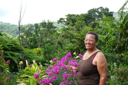 Woman in front of a Creole garden in Martinique.