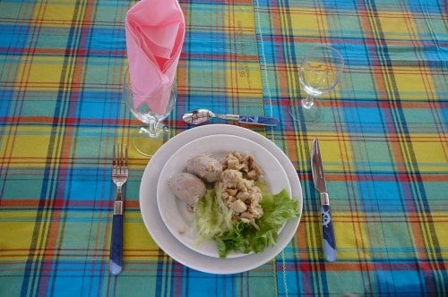 Smoked cod breakfast on a madras tablecloth in Martinique.