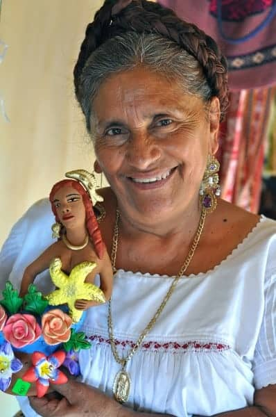 Irene R Aguilar Alcantara and one of her ceramic mermaids