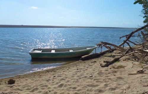 Boat on a sandbank in an estuary near Puerto Escondido.