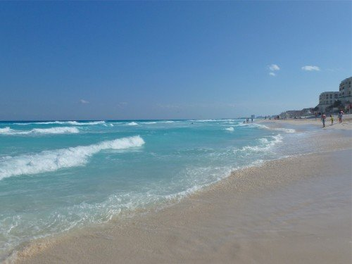 Endless view of the water and sand of the Caribbean Sea at Cancun, Mexico.