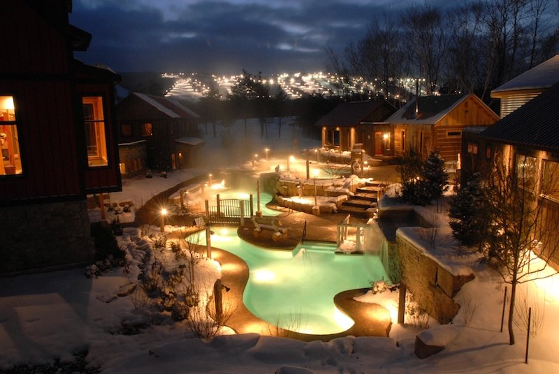Enjoy views of the illuminated ski slopes at Scandinave Spa Blue Mountain. Photo Credit by Robert Burcher.