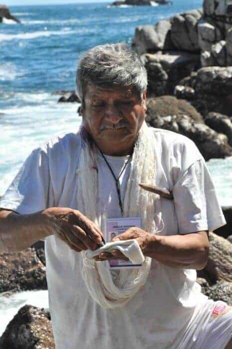 Habacuc Avendano applying snail dye