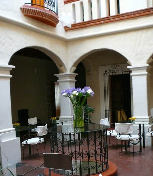 Chairs and pillars of interior courtyard at Casa Catarina hotel in Oaxaca City Mexico.