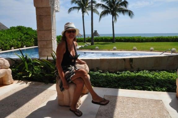 Woman at a swimming pool wearing a sarong.