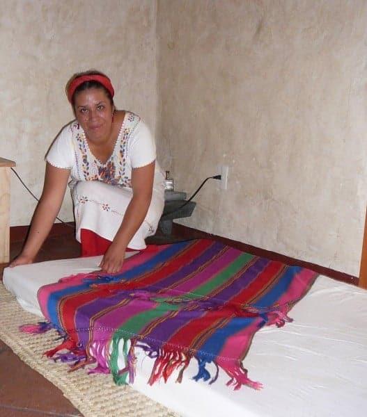 A shaman prepares for a rebozo or shawl massage treatment in Oaxaca Mexico.