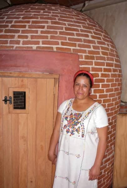 Female shaman standing in front of a temazcal in Oaxaca City, Mexico.