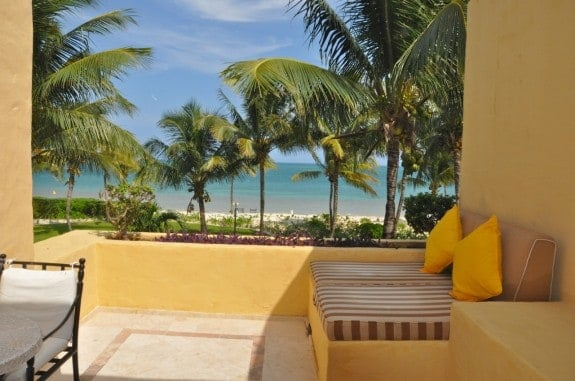 Terrace with view of the Caribbean at Khiva Villa room at Zoetry Resort in Mexico.