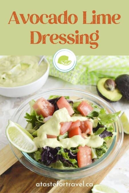 Green salad with avocado dressing with Pinterest text overlay.