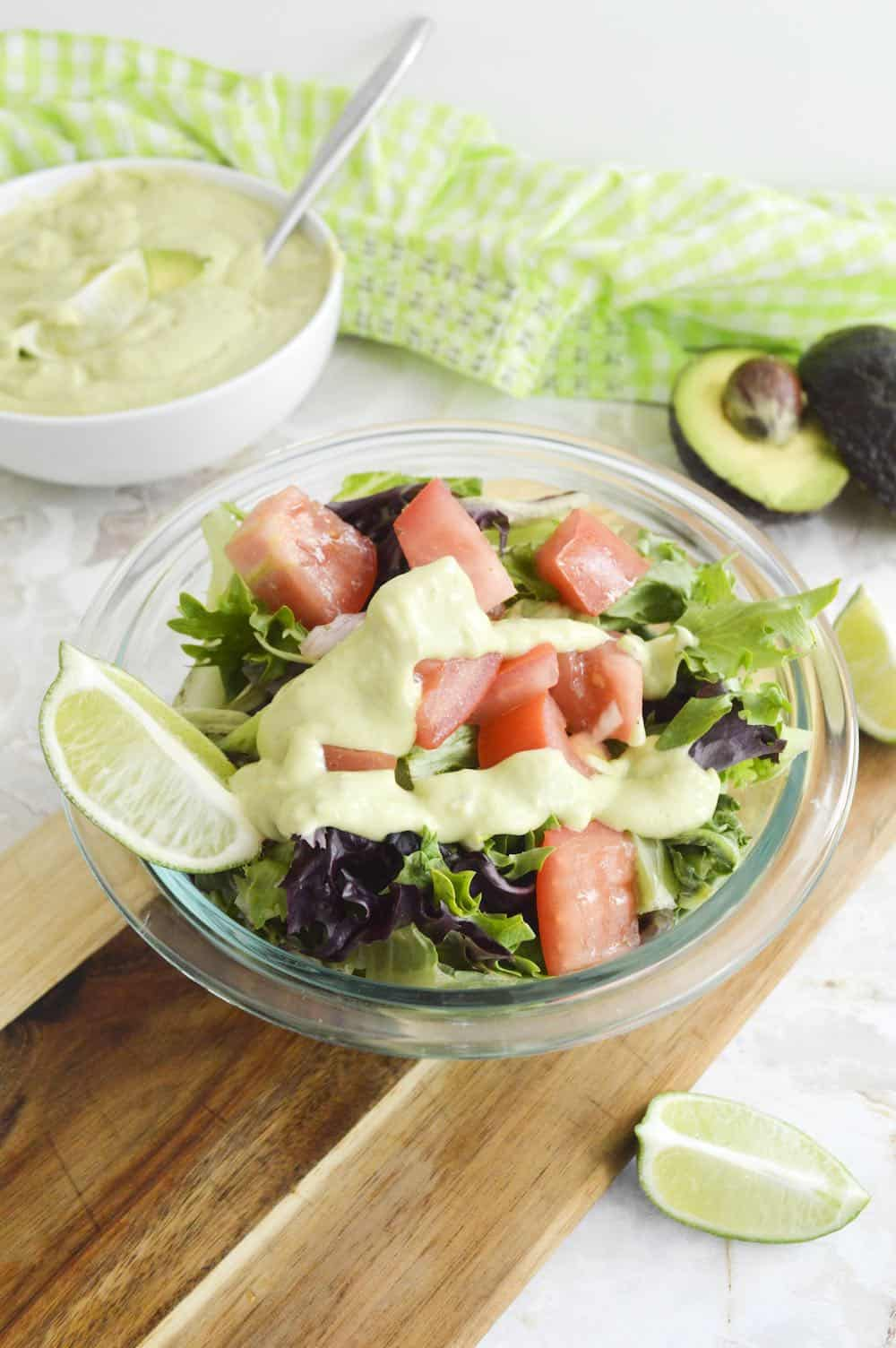 Creamy avocado lime dressing on a green salad.