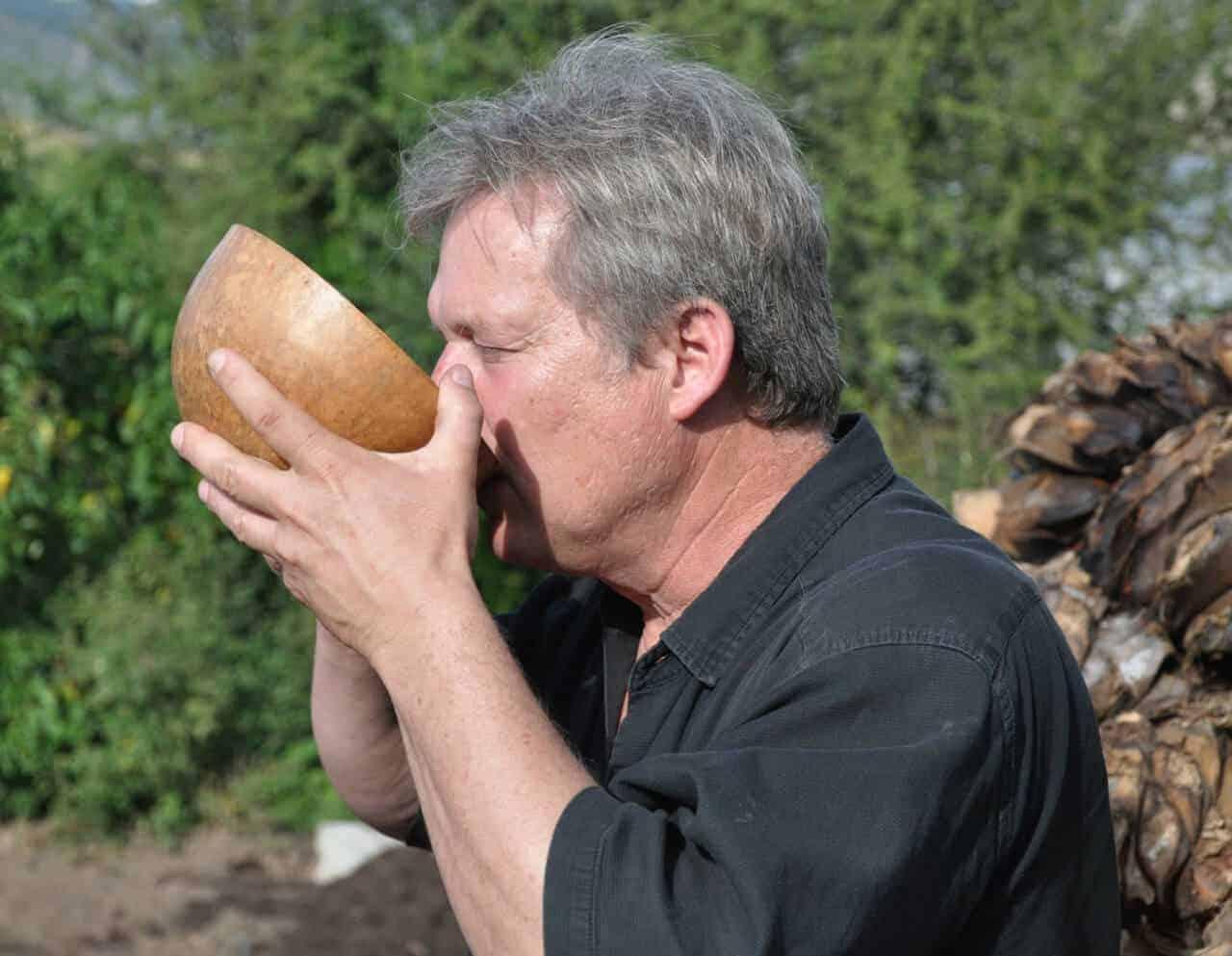 Sampling mezcal in a gourd in Oaxaca Mexico