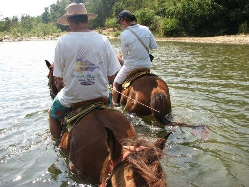 Forging the Manialtepec River by horseback near Puerto Escondido