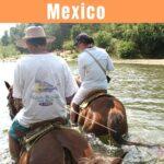 Two people horseback riding to Atotonilco Hot Springs near Puerto Escondido.