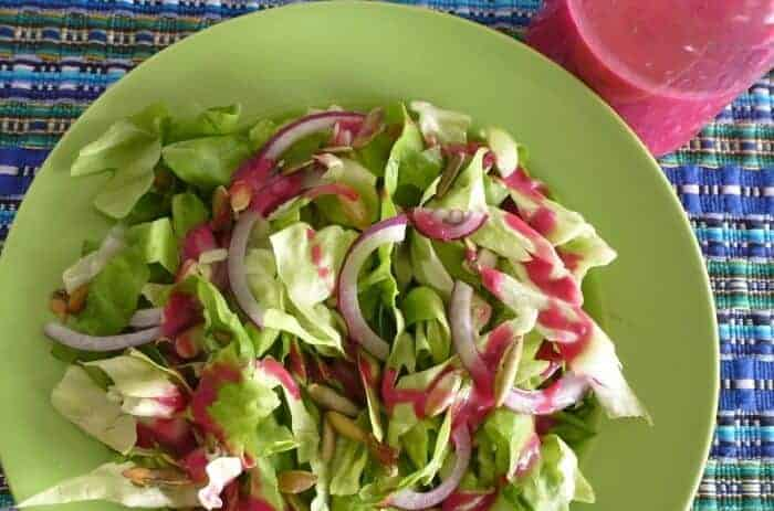 Prickly pear and chia salad dressing drizzled on fresh greens