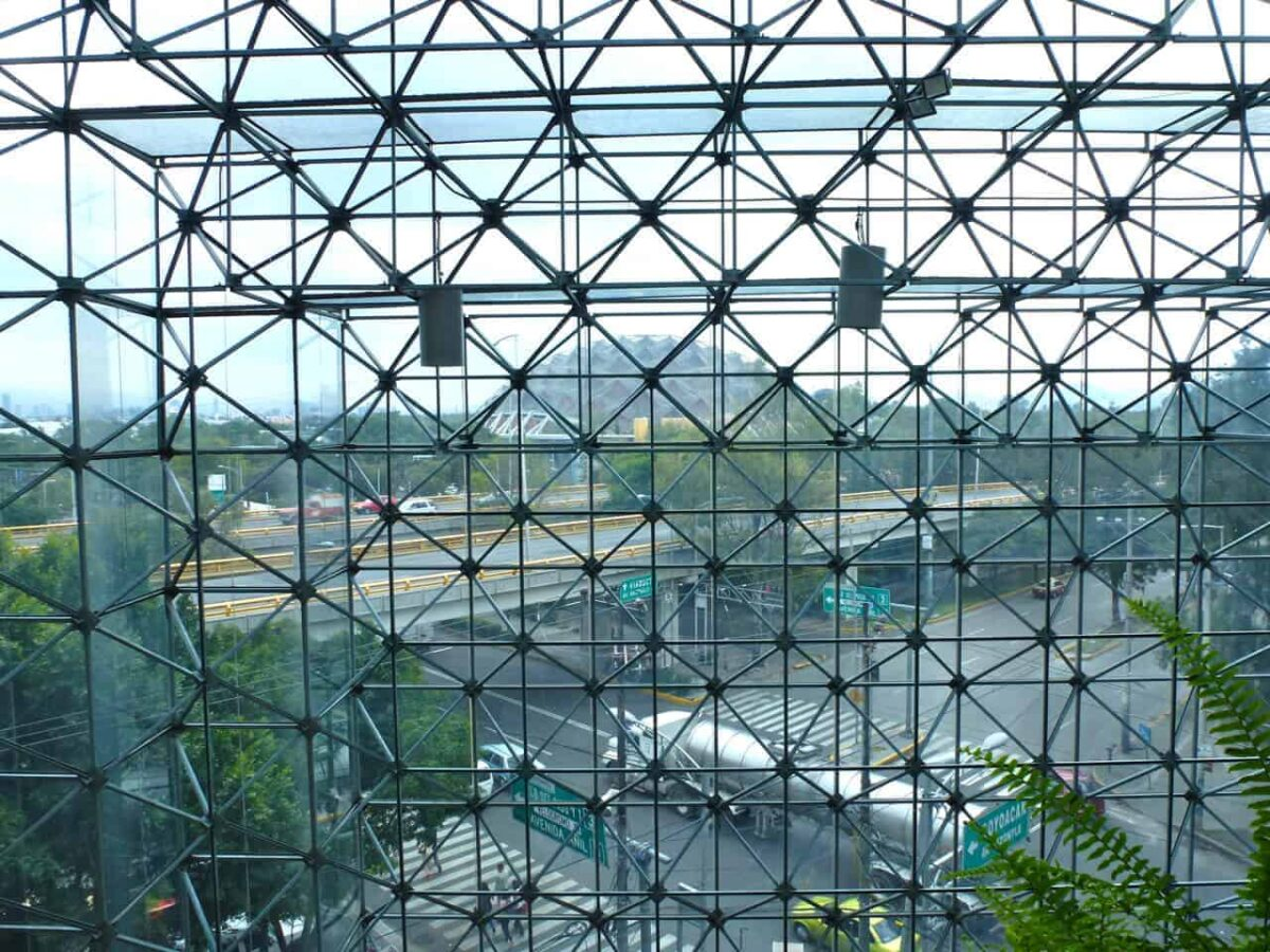 .The geodesic dome of Palacio de los Deportes ( Sports Palace) seen through the courtyard of the Grand Prix Hotel Mexico City