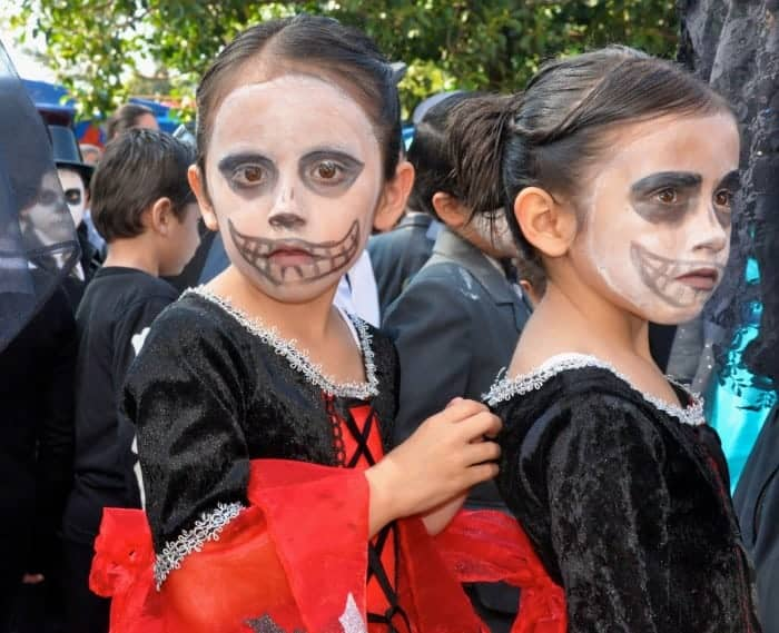 Two little girls in Day of the Dead procession in Patzcuaro