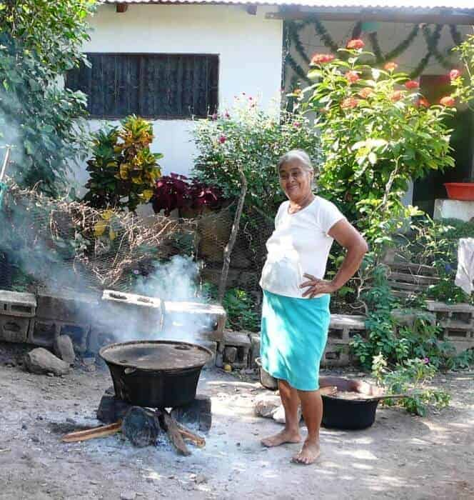 Tia Maria tending her pot of tamales in San Vicente