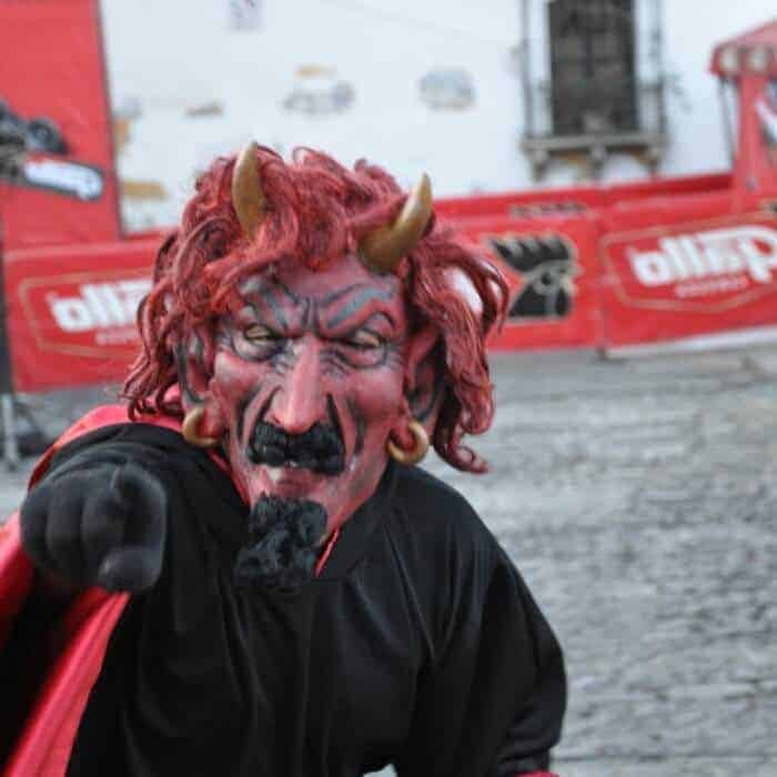 costumed revellers at dia del diablo in Guatemala
