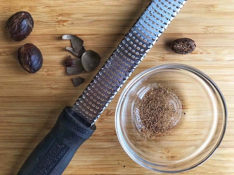 A Microplane zester/grater is a handy tool for grating fresh nutmeg