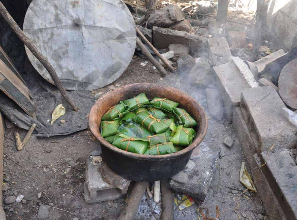 Cooking tamales in a pot in Guatemala