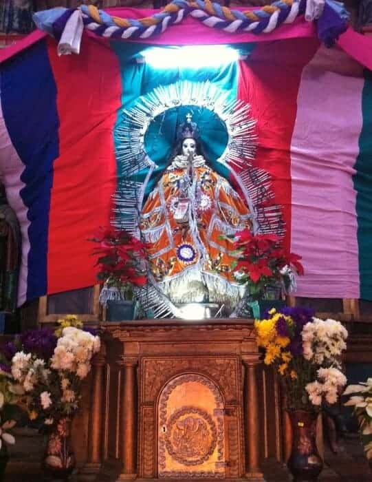 Altar with virgin of concepcion in Solola