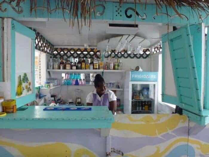 Young girl working at Annie's Kayak Kafe & Juice Bar in Hillsborough, Grenada.