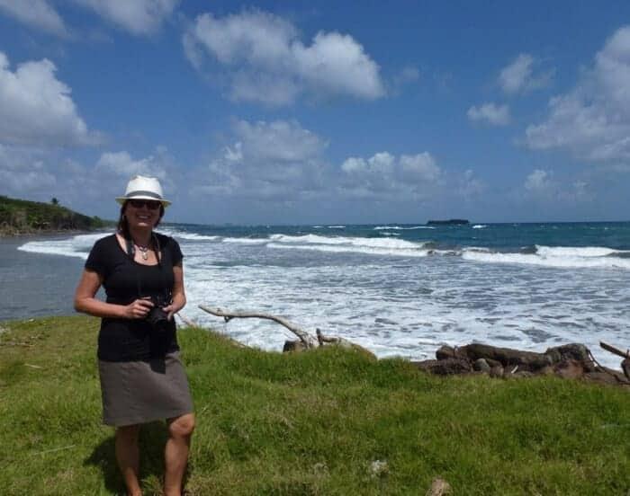 Woman hiking by the ocean in Grenada, Caribbean.