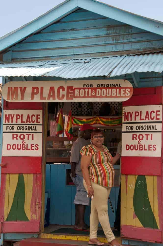 Woman standing in doorway of roti shop in Grenville Grenada.