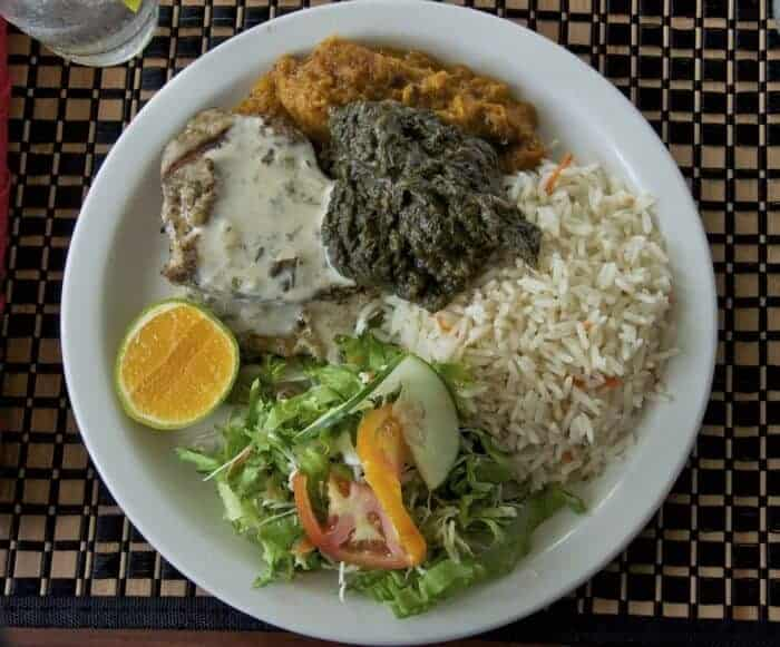 A traditional lunch with grilled fish and nutmeg sauce, stewed pumpkin and callaloo in Grenada