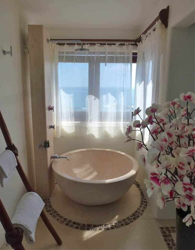 A stylish round bathtub at Zoa resort with an ocean view in Mazunte, Mexico.