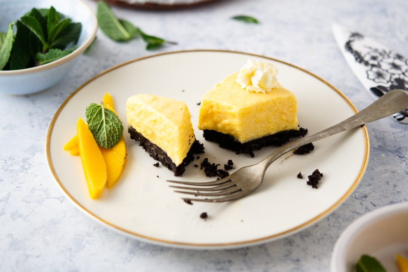 No-Bake Mango Pie on a plate garnished with mint and mango