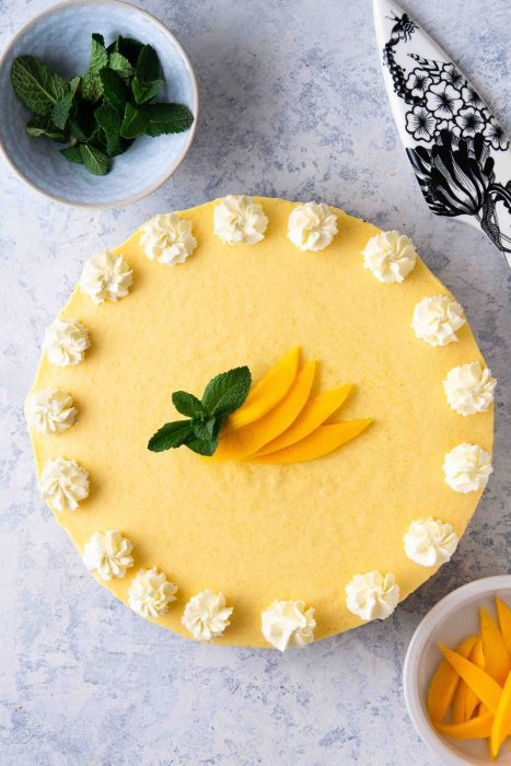 No-Bake Mango Pie with a decorative serving lifter and mint