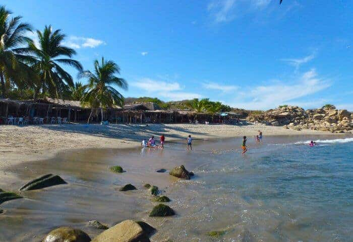 Swimming at Roca Blanca Beach Oaxaca Mexico