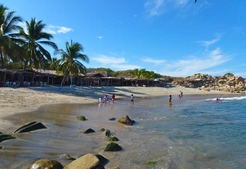 Children swimming at Roca Blanca Beach in Oaxaca Mexico