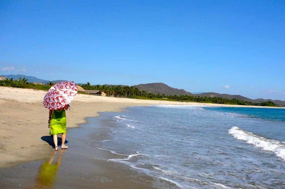 Woman walking on Roca Blanca Beach near Puerto Escondido.