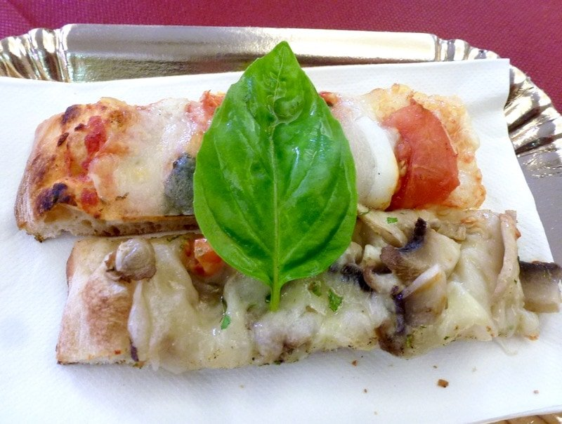 Two pieces of pizza to sample on the Taste of Testaccio food tour.