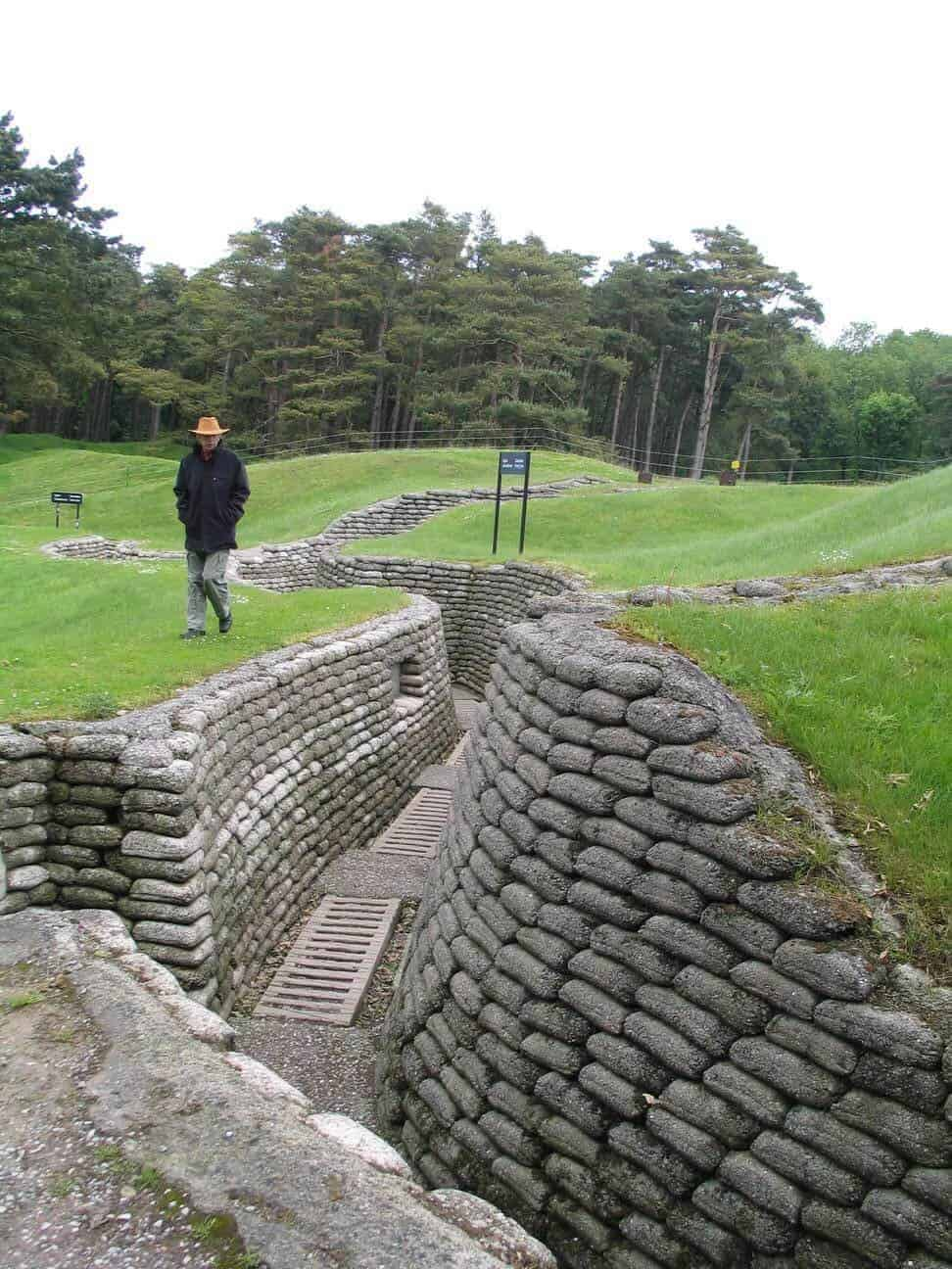 Man walking beside a Canadian trench at Vimy Ridge France