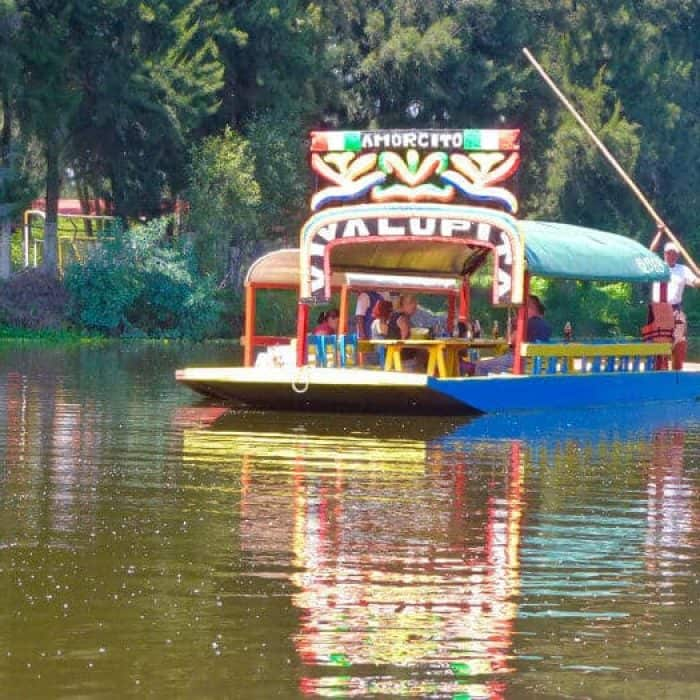 A top thing to do on a weekend in Mexico City is to float on a trajinera or Mexican gondola in Xochimilco.