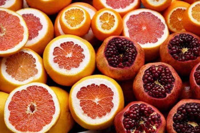oranges and pomegranates Photo by Israel Egío on Unsplash
