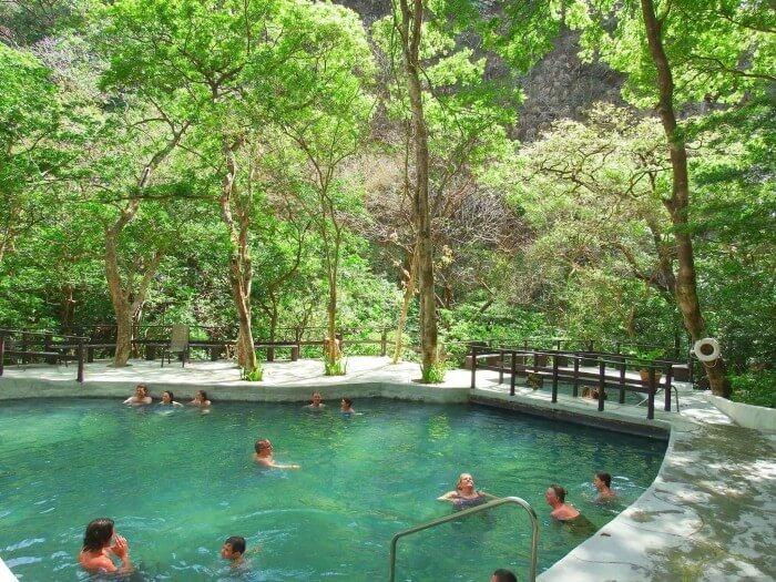 Soaking in a volcanic thermal pool in Rincon de la Vieja Park Costa Rica