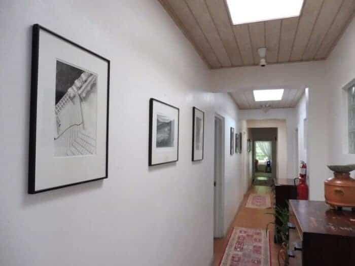 Hallway at Olveston House with photos by Linda McCartney