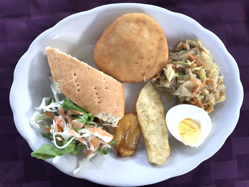 A Grenadian breakfast of saltfish sous and bake