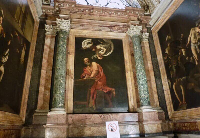 Painting titled The Inspiration of Saint Matthew by Caravaggio, 1599-1600.