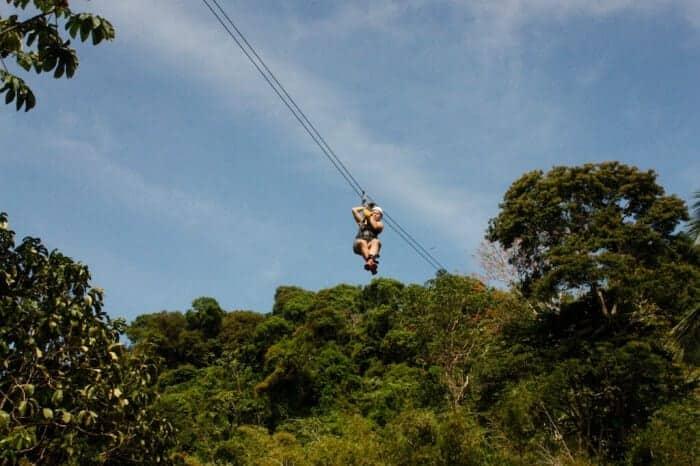 Zipline through tropical rainforest
