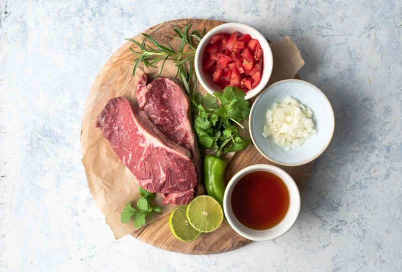 Ingredients for making grilled steak with a fresh salsa