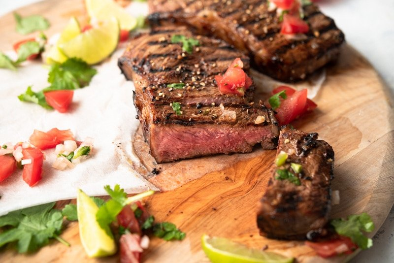 Grilled Steaks on a wooden board with Salsa Fresca