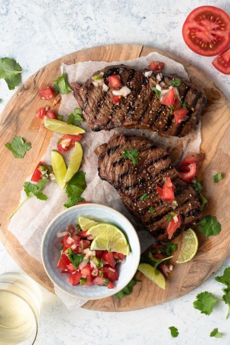 Grilled Steak in a beer and balsamic marinade served with a salsa fresca of tomatoes, onions, cilantro and lime